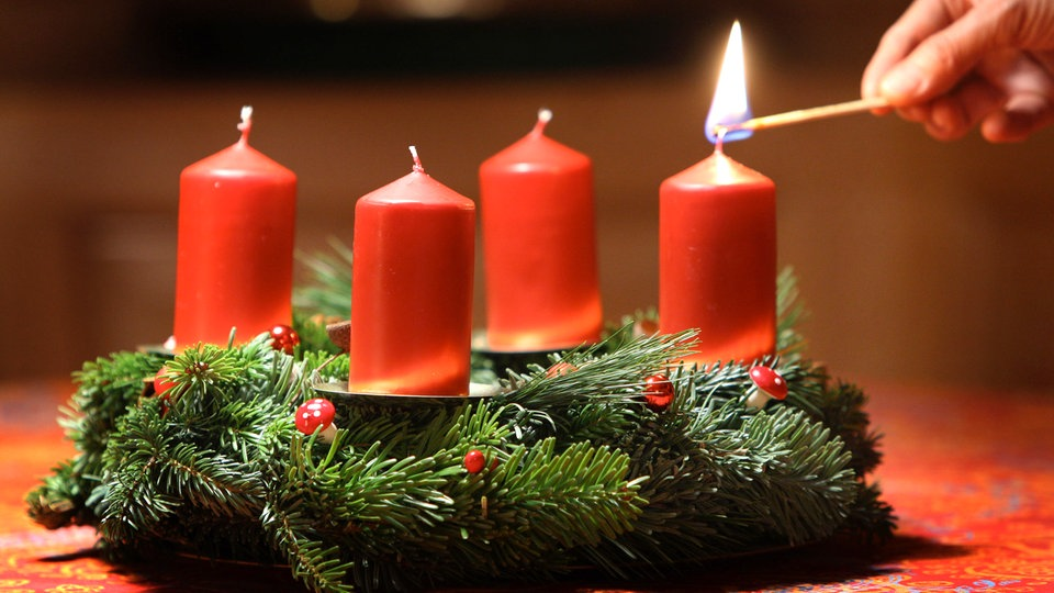 Two burning candles in festive christmas arrangement 2